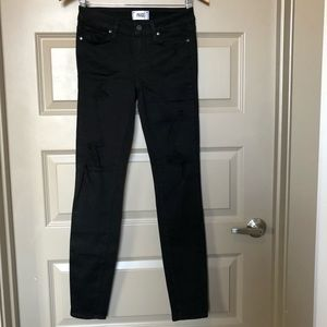 Black paige jeans with holes around the knee/thigh